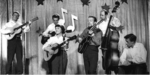 Chas McDevitt Skiffle Group featuring Nancy Whiskey. Chas is the one with the beard.