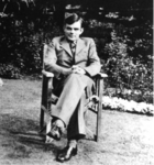 Alan Turing in a chair