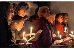 Image - CAROLS_christmas-carol-singers-with-candles